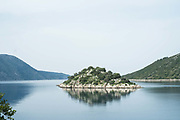 Small islet off Vathy, Ithaca, Greece. The Greek island is situated in the Ionian Sea off the northeast coast of Kefalonia. Since antiquity, Ithaca has been identified as the home of the mythological hero Odysseus.