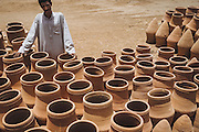 Hassan selling pottery in Balana, near Kom Umbo