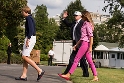 President Donald J. Trump accompanied by First Lady Melania Trump and their son Barron Trump, 11, enter the White House after returning from a weekend trip to Camp David. Credit: Alex Edelman / Pool via CNP