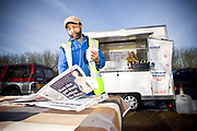 A male lorry driver takes a lunch break and reads the newspaper at Lee Swanson's snack bar on the 1st February 2010 in Bishop Stortford in the United Kingdom.