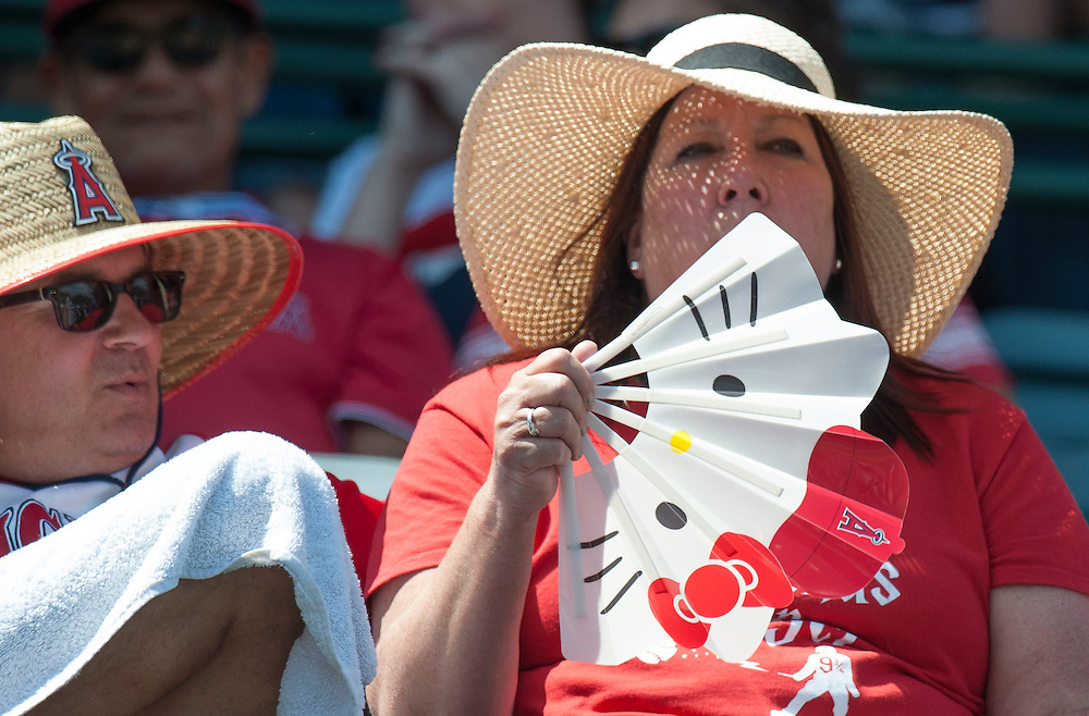 Angel fans try and stay cool during the Angels' preseason game against the Chicago Cubs at Angel Stadium Sunday.<br /> <br /> <br /> ///ADDITIONAL INFO:   <br /> <br /> angels.0404.kjs  ---  Photo by KEVIN SULLIVAN / Orange County Register  --  4/3/16<br /> <br /> The Los Angeles Angels take on the Chicago Cubs at Angel Stadium during a preseason game at Angel Stadium Sunday.<br /> <br /> <br />  4/3/16