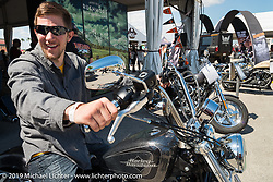 """Shaun Gooch tests the """"72"""" Sportster in the Harley-Davidson display at the Speedway during Daytona Bike Week. FL, USA. March 15, 2014.  Photography ©2014 Michael Lichter."""