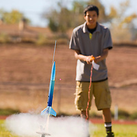 101112       Brian Leddy<br /> Colten Pine launches a rocket at Wingate High School Thursday morning. The Wingate Rocket Club celebrated New Mexico's 100th birthday and Native American week with the launching of a rockets, singing and dancing.