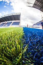 An upright image taken with a fish-eye lens showing the new plastic pitch work at The Falkirk Stadium, with the new pitch work for the Scottish Championship game v Morton. The woven GreenFields MX synthetic turf and the surface has been specifically designed for football with 50mm tufts compared with the longer 65mm which has been used for mixed football and rugby uses.  It is fully FFA two star compliant and conforms to rules laid out by the SPL and SFL.<br /> ©Michael Schofield.