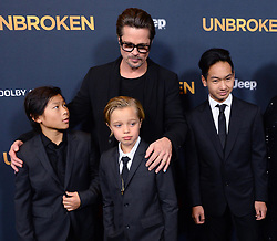 """©2014 NCNA PHOTO 310-828-3445<br /> <br /> Actor Brad Pitt attends the premiere of the biographical motion picture war drama """"Unbroken"""" with his children Pax Thien Jolie-Pitt, Shiloh Nouvel Jolie-Pitt,, Maddox Jolie-Pitt (L-R) and his mother Jane Pitt, and father William Pitt at the Dolby Theatre Theatre in the Hollywood section of Los Angeles on December 15, 2014. Storyline: After a near-fatal plane crash in WWII, Olympian Louis Zamperini spends a harrowing 47 days in a raft with two fellow crewmen before he's caught by the Japanese navy and sent to a prisoner-of-war camp.<br /> <br /> NCNA (Mega Agency TagID: MEGAR12975_10.jpg) [Photo via Mega Agency]"""