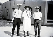 two adult men and woman 1920s USA