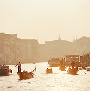 Gondolas on the Grand Canal at sunset, Venice, Italy