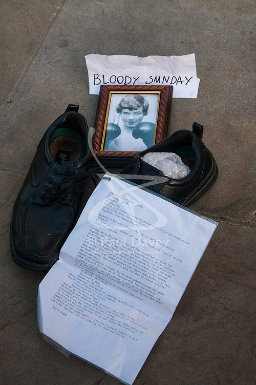 """London, December 10th 2014. The shoes of hundreds of victims who died in Ireland, North and South during the Troubles are lined up opposite Downing Street as families demand that a proper investigation into over 3,600 deaths and 40,000 injuries on all sides, sets the truth free. PICTURED: The poignant memorial of John Francis """"Jackie"""" Duddy who at 17 years old was killed on Bloody Sunday after going to join the march for a """"bit of craic""""."""