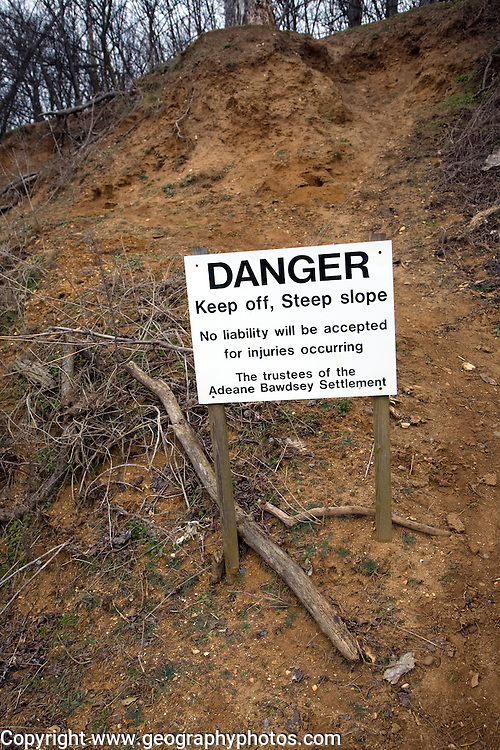Sign danger steep loose cliff of red crag rock Ramsholt, Suffolk