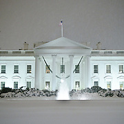 The White House covered in snow at night.