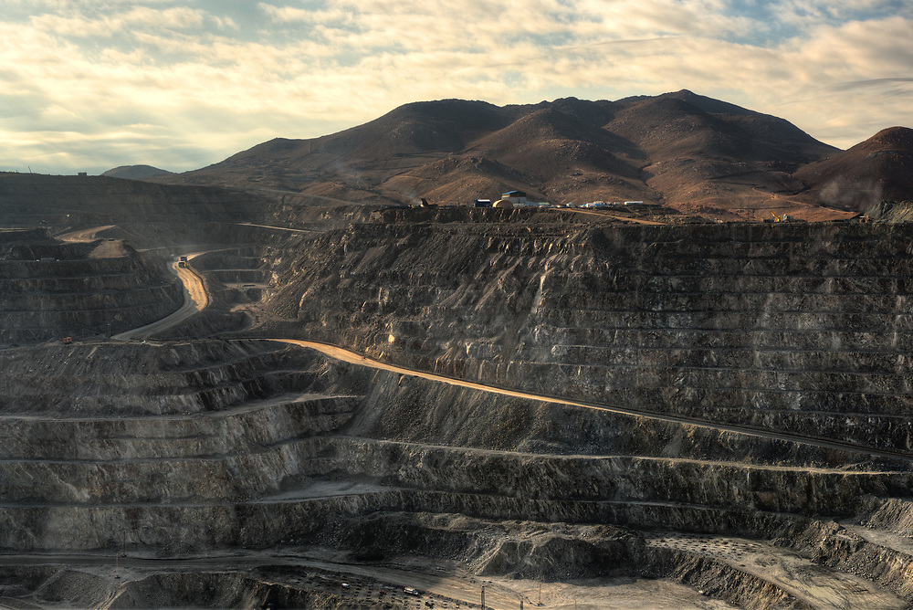 View from above of the pit of an open-pit copper mine in Chile