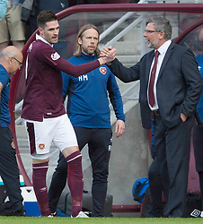 Hearts Kyle Lafferty celebrates scoring his side's first goal of the game with manager Craig Levein during the Ladbrokes Scottish Premiership match at Tynecastle Stadium, Edinburgh.