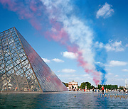 Ending France's Bastille Day parade, the elite 'Red Arrows', Britain's prestigious Royal Air Force aerobatic team, leave a trail of smoke over the pyramid peak of the Louvre art museum in the centre of Paris. Leaving vapour trails of red, white and blue smoke to mark the 100th anniversary of the Anglo-French Entente Cordiale. They were chosen by the French authorities to close the fly-pasts. British armed forces paraded in the historic parade for the first time. Under blue skies on a perfect summer day, the squadron lined up in their classic fly-past 'V-shape' called 'Big Battle', following the straight line of the Champs Elysees then eastwards over the Parisian suburbs. Personnel from four British military units were present and French Air Force jets performed their own fly-past to open the parade, while the British Hawk jets of the Red Arrows had the honour of completing it. .