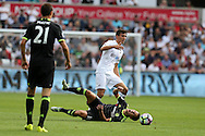 Jack Cork of Swansea city fouls Eden Hazard of Chelsea. Premier league match, Swansea city v Chelsea at the Liberty Stadium in Swansea, South Wales on Sunday 11th Sept 2016.<br /> pic by  Andrew Orchard, Andrew Orchard sports photography.