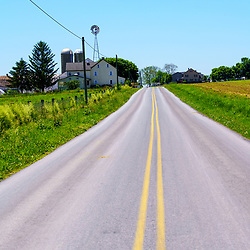 Gordonville, PA, USA / June 8, 2020: A typical road in  rural Lancaster County where Amish and Mennonite farms are located.