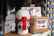 With new local coronavirus lockdown measures now in place and Birmingham currently set at 'Tier 2' or 'high', a souvenir shop selling Union Jack face masks in the city centre on 14th October 2020 in Birmingham, United Kingdom. This is the first day of the new three tier system in the UK which has levels: 'medium', which includes the rule of six, 'high', which will cover most areas under current restrictions; and 'very high' for those areas with particularly high case numbers. Meanwhile there have been calls by politicians for a 'circuit breaker' complete lockdown to be announced to help the growing spread of the Covid-19 virus.