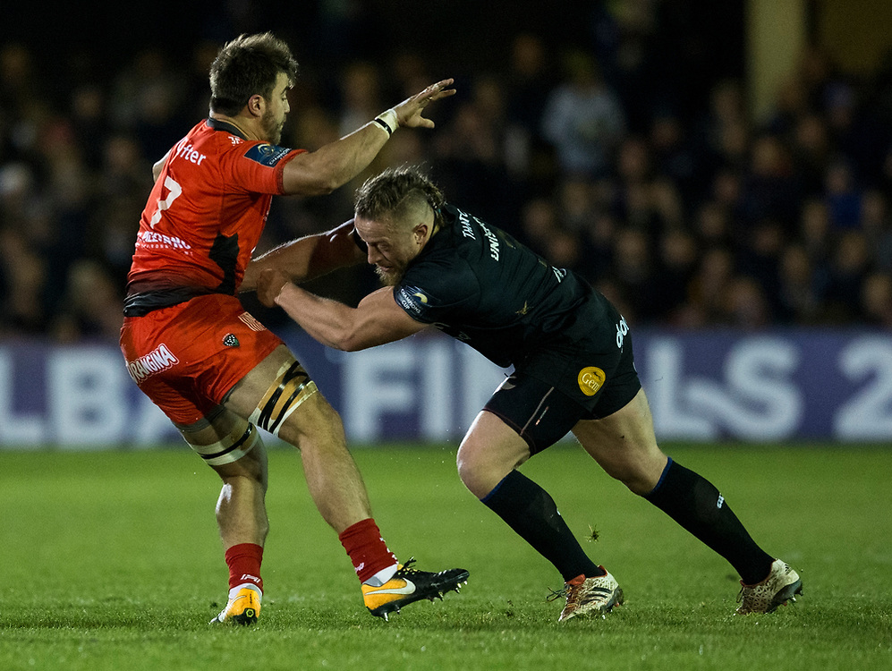 Toulon's Facundo Isa is tackled by Bath Rugby's Max Lahiff<br /> <br /> Photographer Bob Bradford/CameraSport<br /> <br /> European Rugby Champions Cup Pool 5 - Bath Rugby v Toulon - Saturday 16th December 2017 - The Recreation Ground - Bath<br /> <br /> World Copyright © 2017 CameraSport. All rights reserved. 43 Linden Ave. Countesthorpe. Leicester. England. LE8 5PG - Tel: +44 (0) 116 277 4147 - admin@camerasport.com - www.camerasport.com