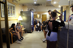 August 18, 2017 - unknown - Barcelona, Spain, August 17, 2017, late afternoon : view of tourists shelting at the reception of a hotel after a white van running over tourist pedestrians walking down the Rambla in the same style of the Nice or London terrorist attack in 2016 and 2017. Photo credit : Marc Javierre-Kohan / Aurimages (Credit Image: © Marc Javierre Kohan/Aurimages via ZUMA Press)