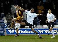 Photo: Leigh Quinnell.<br /> Luton Town v Hull City. Coca Cola Championship. 13/03/2007. Hulls Ian Ashbee battles with Lutons Clarke Carlisle.