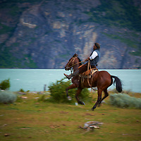 Gaucho riding a horse at Estancia Helsingfors in Patagonia. Image taken with a Nikon D3s camera and 24-120 mm f/4  lens (ISO 200, 120 mm, f/16, 1/50 sec)