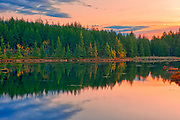 Dawn light on small northern lake. Adjacent Regional Road 80 (Old Highway 69). <br />Sudbury<br />Ontario<br />Canada