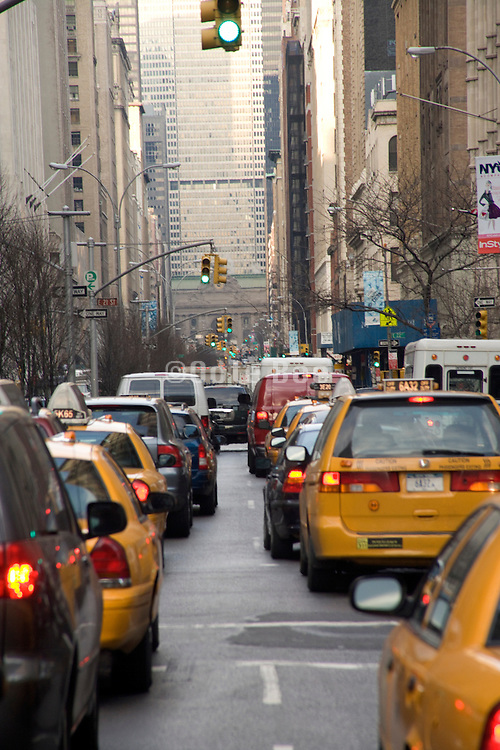 a typical New York City street filled with yellow cabs at rush hour Park Avenue at 24th street