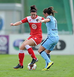Bristol Academy Womens' Jasmine Matthews is closed down by Manchester City Womens' Krystle Johnston - Photo mandatory by-line: Dougie Allward/JMP - Mobile: 07966 386802 - 28/09/2014 - SPORT - Women's Football - Bristol - SGS Wise Campus - Bristol Academy Women's v Manchester City Women's - Women's Super League