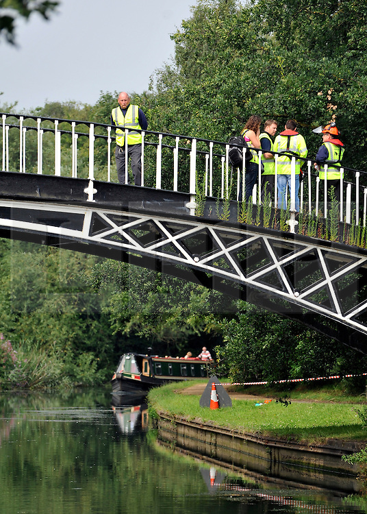 © licensed to London News Pictures.  29/07/11. London, UK. British Waterways  workers inspects trees for  nests along Grand Union Canal at Brentford, West London today (29/07/2011) in an attempt to eradicate the dangerous alien Oak Processionary Moth.  The moths are hazardous to human health and strip English oak trees of foliage which can ultimately cause the trees to die. As pesticides are not allowed to be used near water, the moths must be 'sucked' out of the trees. The Oak Processionary Moth (OMP), which is native to southern and central Europe have irritating hairs that carry a dangerous toxin. The hairs are easily blown in the wind causing serious irritation to the skin, eyes and bronchial tubes of both humans and animals. Photo credit Stephen Simpson/LNP
