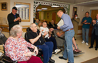 John Walker presents John Neylon U.S. Marines Corps with a plaque of appreciation during a ceremony held Tuesday afternoon for veterans at the Belknap County Nursing Home.  (Karen Bobotas/for the Laconia Daily Sun)