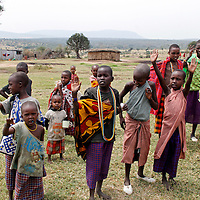 Africa, Kenya, Masai Mara. Maasai children of Olderkesi Community.