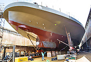 A view beneath the hull of the Chimacum ferry, under construction, in a dry dock at Vigor Shipyard in Seattle. (Mike Siegel/The Seattle Times)