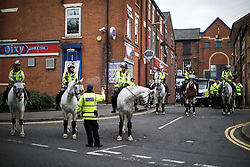 © Licensed to London News Pictures . 29/07/2017 . Rochdale , UK . Mounted police at the march . Far-right street protest movement , the English Defence League ( EDL ) , hold a demonstration in Rochdale , opposed by anti-fascists , including Unite Against Fascism ( UAF ) . The EDL say they are demonstrating against the sexual grooming and abuse of English girls by Muslim men in Rochdale and against terrorism across the UK . Photo credit : Joel Goodman/LNP