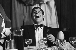 Merry Prince Andrew throws his head back in laughter at the London Hilton Hotel, where he made his first public speech at a dinner celebrating the 100th Varsity match which he had watched Cambridge win yesterday at Twickenham.