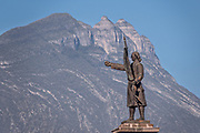 Statue of independence hero Miguel Hidalgo with Cerro de la Silla or Saddle Mountain behind in the Macroplaza Grand Plaza in the Barrio Antiguo neighborhood of Monterrey, Nuevo Leon, Mexico.
