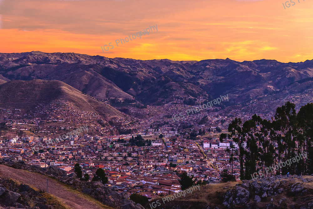 Sunset over Cusco viewed from the heights around Quenco