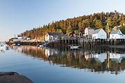 Sunrise reflections in Stonington Harbor, Maine
