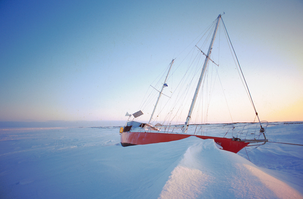 Boat in snow and ice on a beach in Barrow, far from the water past the frozen Chukchi Sea