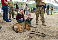 Caleb and Jacob Funk meet K-9 Raven of the Navy Seal Team at Wellington State Beach on Friday.  (Karen Bobotas/for the Laconia Daily Sun)