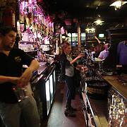 O'Donoghue's Bar, Dublin, Ireland..O'Donoghue's is known for it's traditional Irish music. It has been frequented of the years by many musicians from the Dubliner's to Bruce Springsteen. O'Donoghue's is recognized as one of Dublin's most famous pubs and is frequented by locals and tourist alike to play a tune or enjoy a pint of Guinness. Dublin, Ireland. Photo Tim Clayton