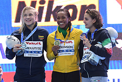 HANGZHOU, Dec. 12, 2018  Gold medalist Alia Atkinson (C) of Jamaica pose with silver medalist Ruta Meilutyte (L) of Lithuania, bronze medalist Martina Carraro of Italy during the awarding ceremony of Women's 50m Breaststroke Final at 14th FINA World Swimming Championships (25m) in Hangzhou, east China's Zhejiang Province, on Dec. 12, 2018. Alia Atkinson claimed the title with 29.05 seconds. (Credit Image: © Xinhua via ZUMA Wire)