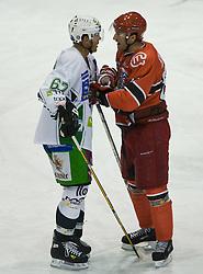 Matt Higgins of Olimpija vs Sabahudin Kovacevic of Jesenice at 14th Round of EBEL league  ice hockey match between HK Acroni Jesenice and HDD Tilia Olimpija Ljubljana, on October 16, 2009, in Arena Podmezaklja, Jesenice. (Photo by Vid Ponikvar / Sportida)