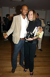MR CONRAD PERSONS and his fiance LARISSA HOWARD daughter of Michael Howard  at a party to celebrate the publication of Glass Houses by Sandra Howard held at Tamesa, Oxo Tower Wharf, Barge House Street, London SE1 on 5th September 2006.<br />
