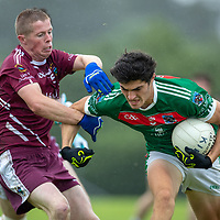 Kilmurry Ibrickane's Aidan McCarthy is tackled by Lissycasey's Cyril Sheehan
