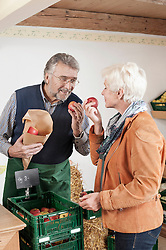 Mature woman buying fruits in the store, Bavaria, Germany