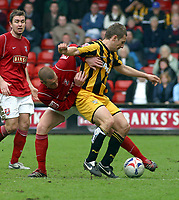 Photo: Dave Linney.<br />Walsall v Port Vale. Coca Cola League 1. 15/04/2006.<br />Walsall's James Constable(L) battles for the ball with  Michael Walsh