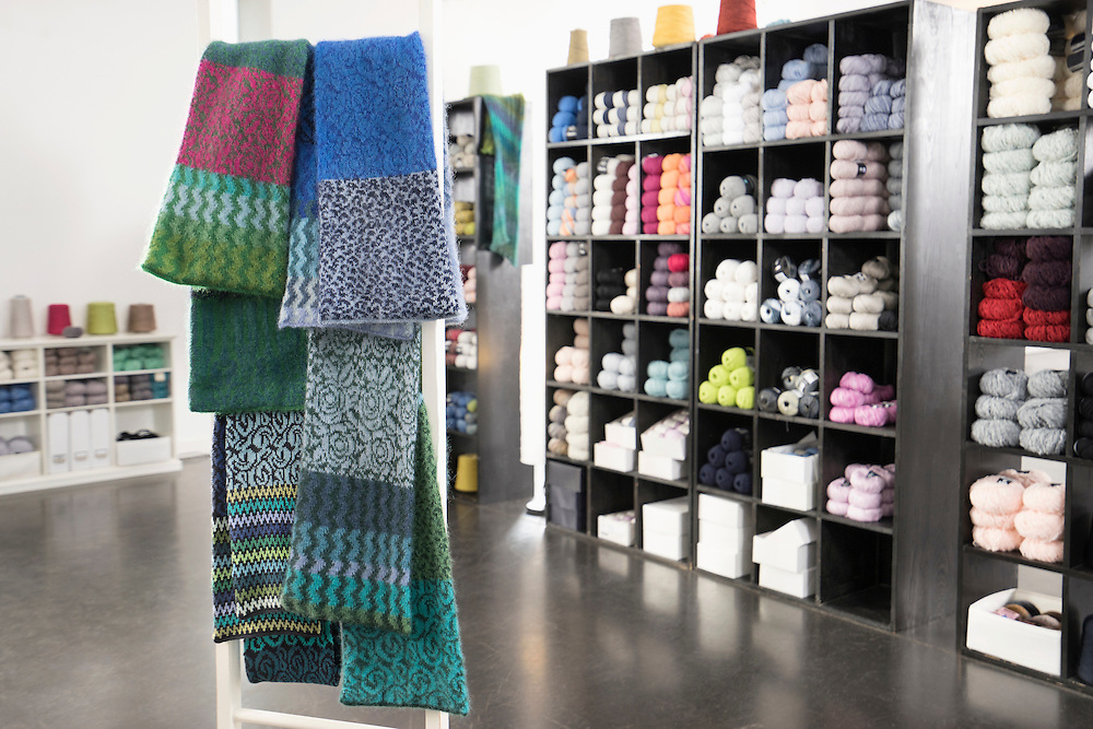 Handcrafted woolen scarves for sale at clothes shop, Bavaria, Germany