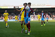 Scunthorpe United defender Tom Pearce (16) shields the ball from Wimbledon defender Toby Sibbick (20)  during the EFL Sky Bet League 1 match between Scunthorpe United and AFC Wimbledon at Glanford Park, Scunthorpe, England on 30 March 2019.