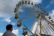 People ride on a carnival Ferris wheel on the day of German Unity in Berlin, Germany, October 02, 2016.