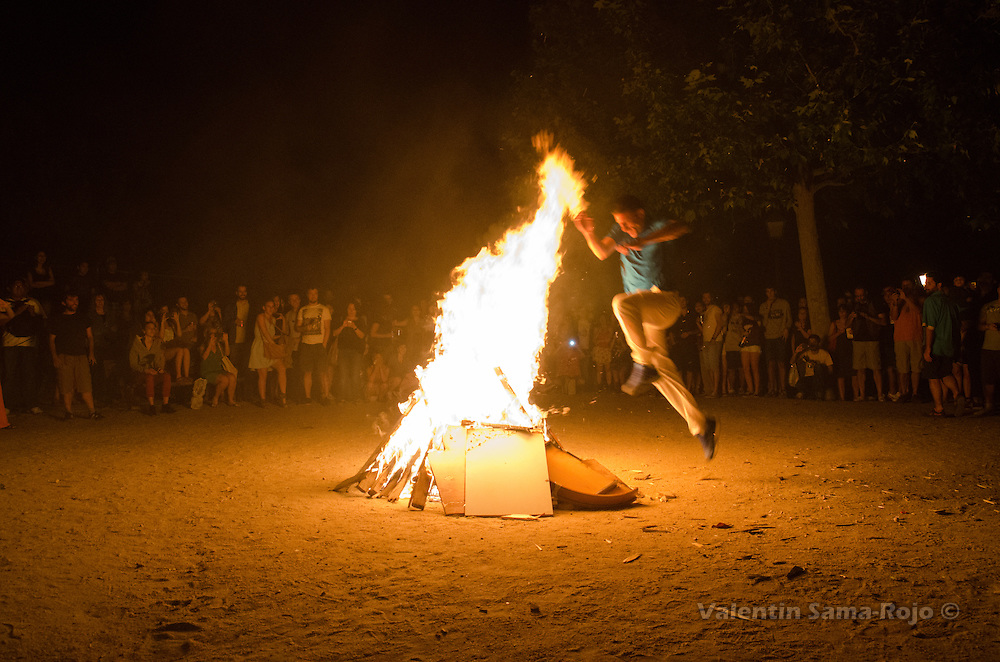 A man jumping a bonfire during Saint John's Eve in Madrid.