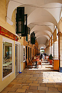 Shopping Arcades of Corfu Old Town, Greek Ionian Islands .<br /> <br /> If you prefer to buy from our ALAMY PHOTO LIBRARY  Collection visit : https://www.alamy.com/portfolio/paul-williams-funkystock/corfugreece.html <br /> <br /> Visit our GREECE PHOTO COLLECTIONS for more photos to download or buy as wall art prints https://funkystock.photoshelter.com/gallery-collection/Pictures-Images-of-Greece-Photos-of-Greek-Historic-Landmark-Sites/C0000w6e8OkknEb8